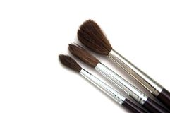 Paint brushes. Three different paint brushes isolated on a white background Stock Photos