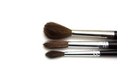 Paint brushes. Three different paint brushes isolated on a white background Royalty Free Stock Photos