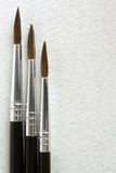 Paint brushes. On paper background, a vertical picture Royalty Free Stock Photo