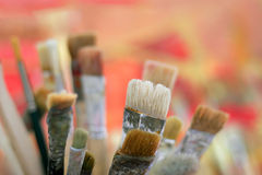 Paint brushes. Against colored background royalty free stock image