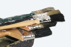 Paint Brushes. Used paint brushes of different sizes and shapes, on a white background royalty free stock images