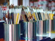 Paint brushes. A several paint brushes in cans Royalty Free Stock Photo
