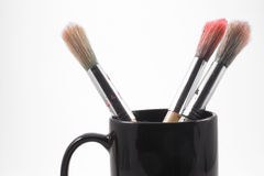 Paint brushes. In a cup on a neutral background Stock Image
