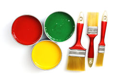 Paint and brushes Stock Images
