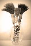 Paint Brushes. Image of Chinese paint brushes in glass vase Royalty Free Stock Photography