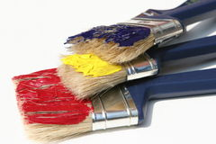 Paint brushes. Three brushes covered with paint stock photo