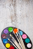 Paint and brushes Stock Photography