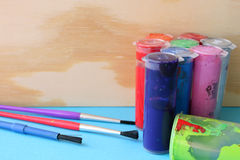 Paint and Brushes. Arts and crafts paint, brushes and wooden items Royalty Free Stock Image