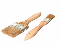 Paint Brushes. With wooden handles in two sizes royalty free stock photo