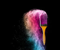 Paint brushes with abstract powder color explosion isolated on b. Lack background full color concept stock image