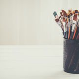 Paint brushes in a artist studio. Copy space for text. Stock Photography