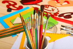 Paint brushes on background of stationery. Selective focus Stock Image