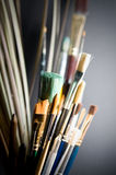 Paint brushes with black background. Variety of artist's paint brushes with black background stock images