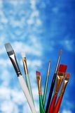 Paint brushes on a blue and white background Royalty Free Stock Photography
