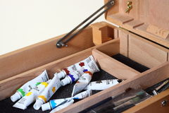 Paint and brushes in a box Stock Images