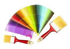 Paint brushes and bright palette of colors stock photos