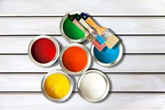 Paint brushes and paint cans for repair on wooden. Paint brushes cans measuring tape wooden background color colors stock photos