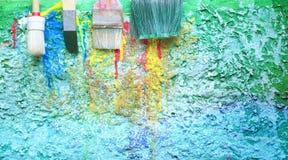 Paint brushes on canvas Stock Photo