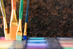 Paint brushes and color box Royalty Free Stock Photo
