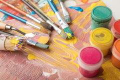 Paint brushes and color containers Royalty Free Stock Image