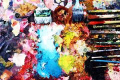 Paint brushes and ful painter Royalty Free Stock Photo