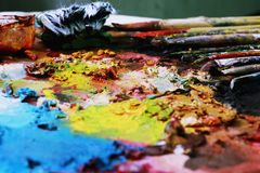 Paint brushes and ful painter Stock Photography