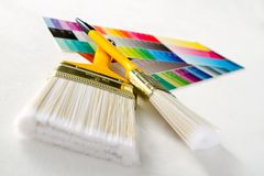 Paint brushes with color guide Royalty Free Stock Photography