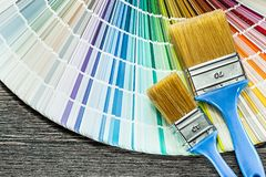 Paint brushes color palette on wooden board.  stock photo