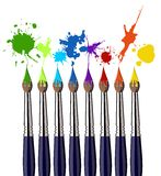 Paint brushes and color splash Stock Image
