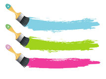 Paint brushes with color splashes Royalty Free Stock Photos
