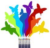 Paint brushes and colored butterflies rainbow. Eight paint brushes drawing a colorful rainbow of a butterfly swarm.  White background. Vector file available Royalty Free Stock Image