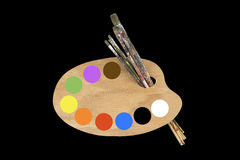 Paint brushes, colors and artist palette Royalty Free Stock Photography