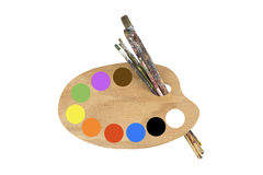 Paint brushes, colors and artist palette Stock Images