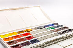 Paint brushes, colors and pallet Stock Image