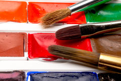 Paint brushes, colors and pallet Stock Photo