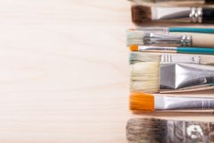 Paint brushes concept ready for your text. Art paint brushes in a row stock photography