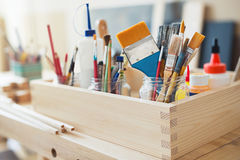 Paint brushes and crafting supplies Stock Images