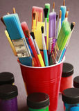 Paint brushes in cup Royalty Free Stock Photo