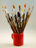 Paint brushes in a cup Royalty Free Stock Photos