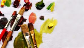 Paint brushes and different paint pigments Royalty Free Stock Image