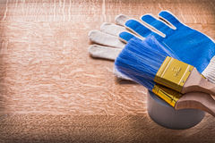 Paint brushes on duct tape and protective gloves Royalty Free Stock Photography