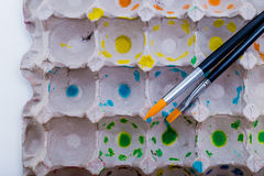 Paint brushes and egg carton Royalty Free Stock Photos