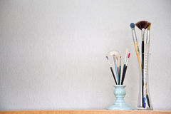 Paint Brushes. And empty wall royalty free stock photo