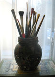Paint brushes in glass jar royalty free stock photos