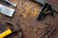 Paint brushes and hammer tools. Top angle flat lay stock photos
