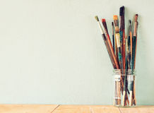 Free Paint Brushes In Jar Over Wooden Aqua Blue Background Stock Photography - 51064072
