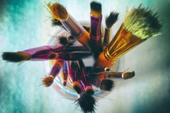 Paint brushes in jar Royalty Free Stock Photography
