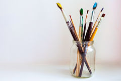 Paint brushes in jar Stock Photos
