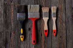 Paint brushes. Lying on painted wooden boards Stock Photography