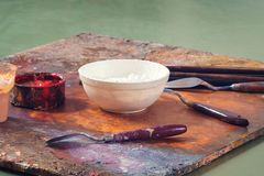 Paint brushes and oil paints stock photos